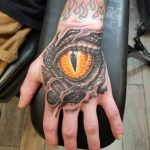 Hand tattoo, dragon eye tattoo