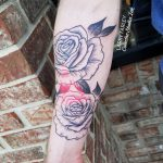 Custom tattoo, black and white flower, red triangle